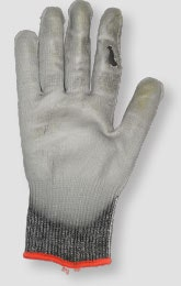 Image of a glove with holes that needs to be discarded and replaced